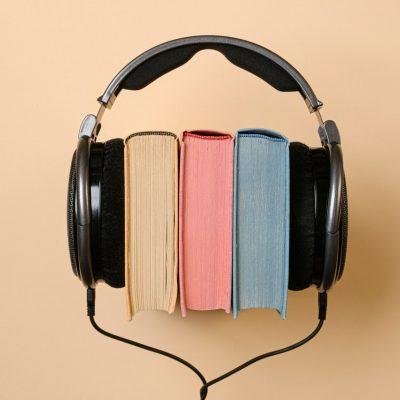 headphones and books neutrals