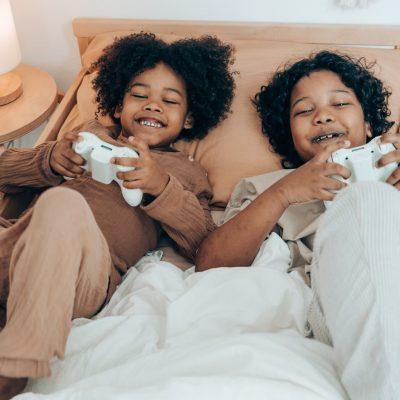 kids smiling playing video games